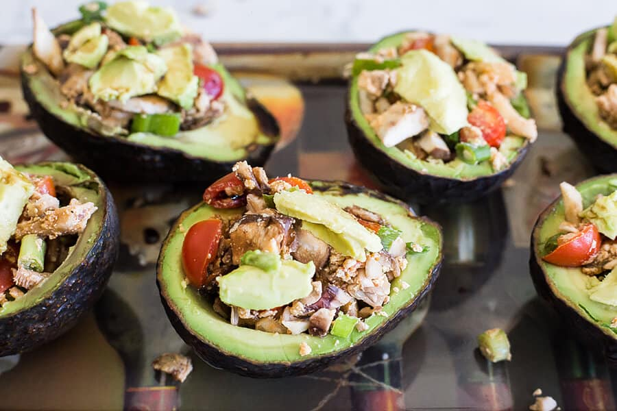 1/2 avocados stuffed with mushrooms and other ingredients, 6 pieces on a countertop