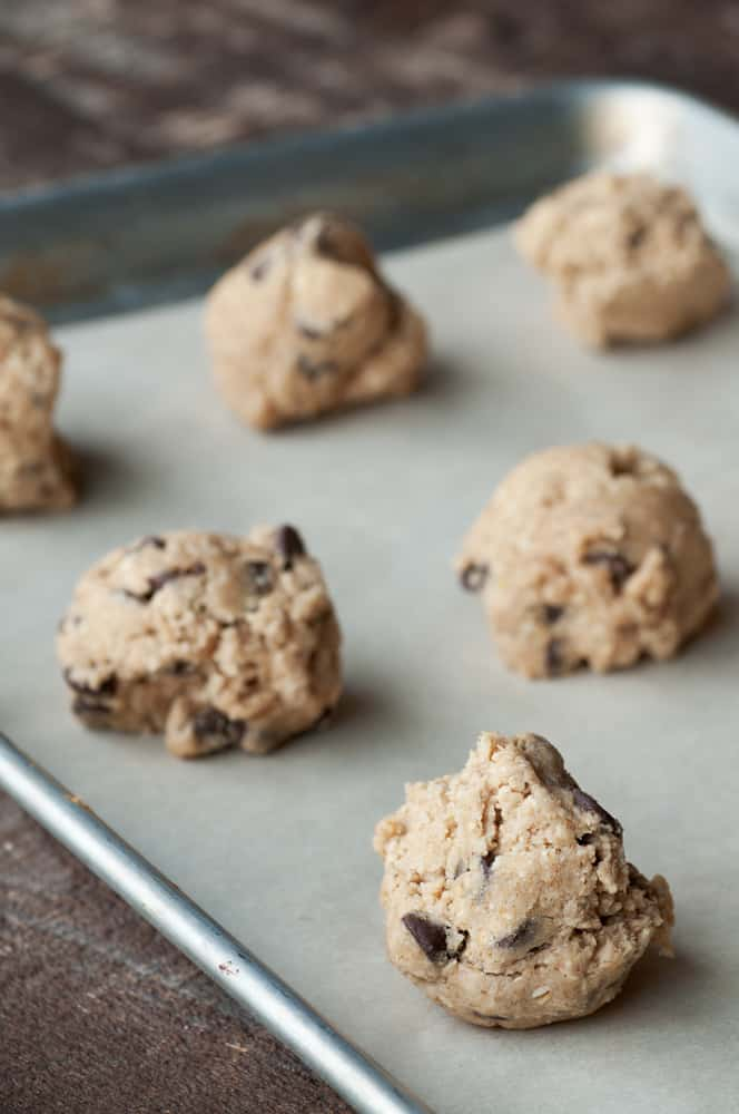 Chocolate Chip Cookie Dough on baking sheet with wax paper underneath