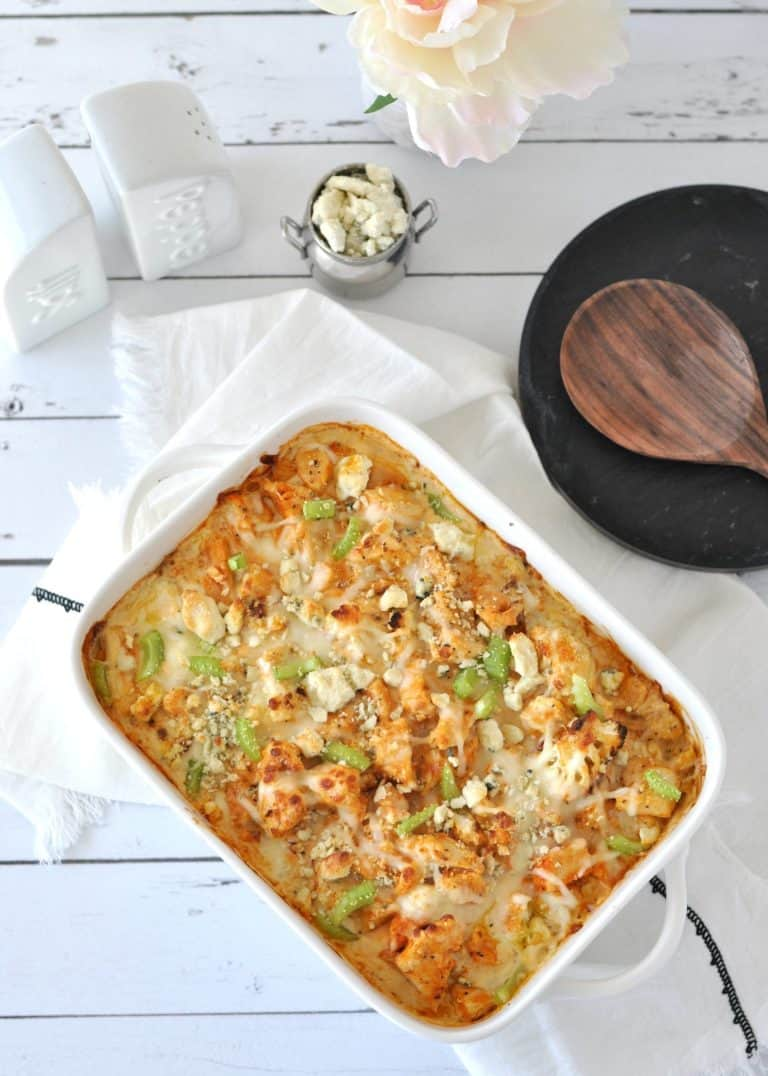 Ketogenic Mac & Cheese in casserole dish next to wooden spoon