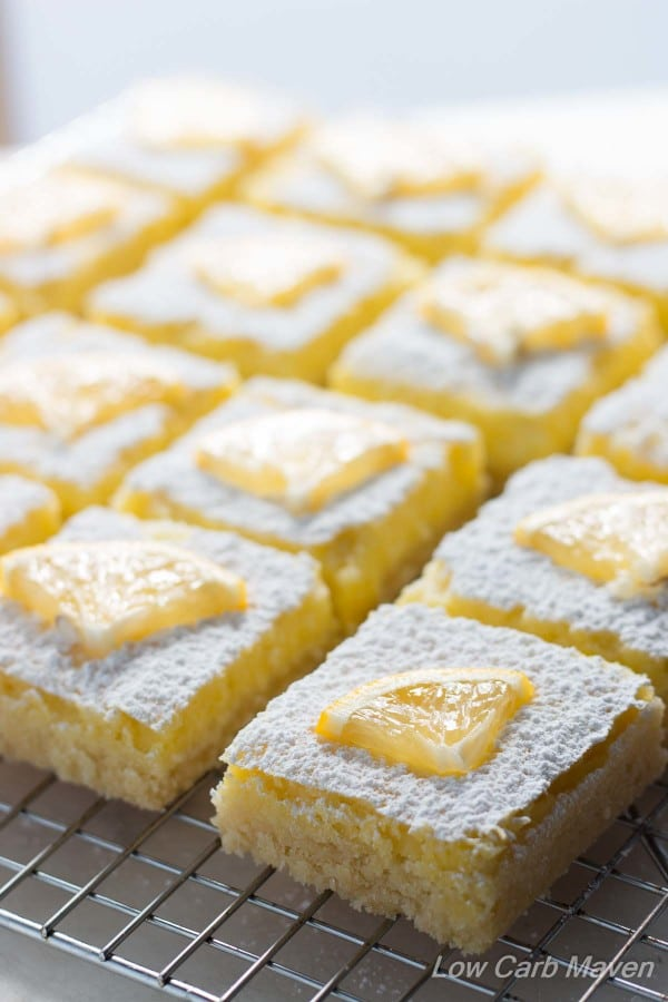 Lemon bars with lemon slice on top on baking sheet