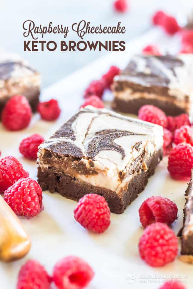 Healthy Rasberry Cheesecake Brownies surrounded by rasberries