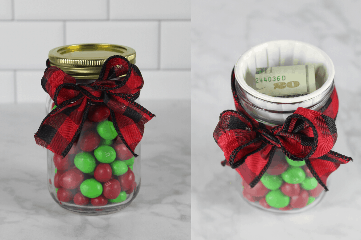 Mason jar filled with candy with bow next to a mason jar with lid off showing cash inside