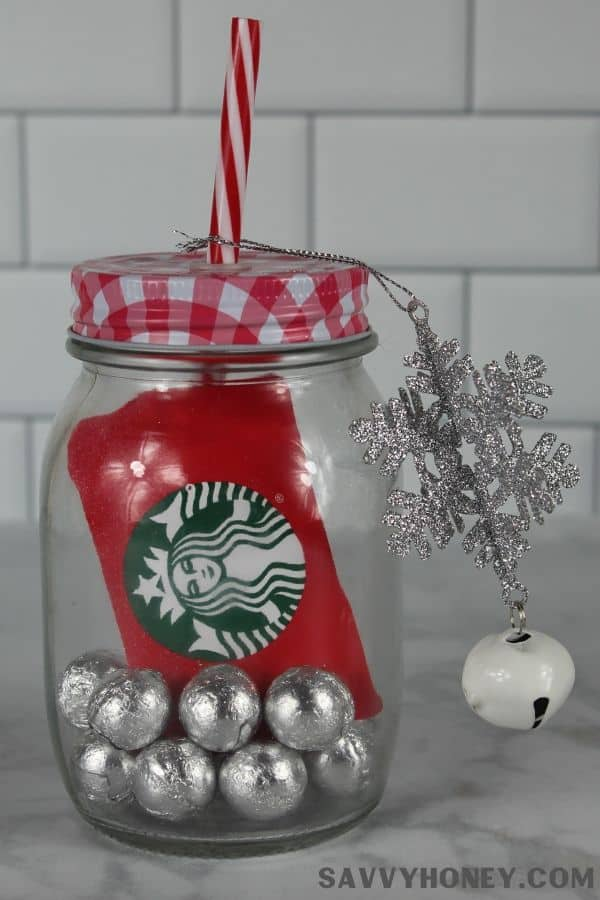 DIY holiday gift card in mason jar cup with candy and ornament topper