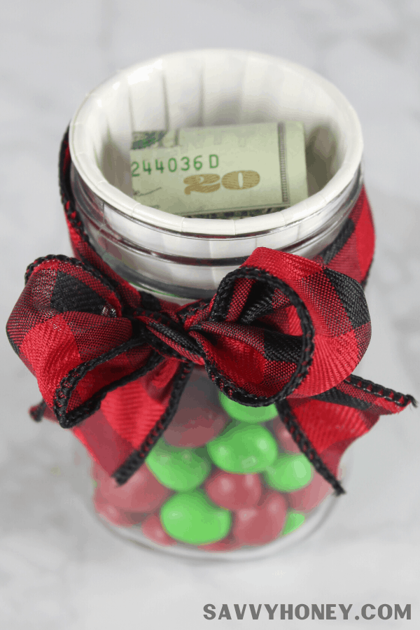Jar with candy and bow around it with money on top & no lid