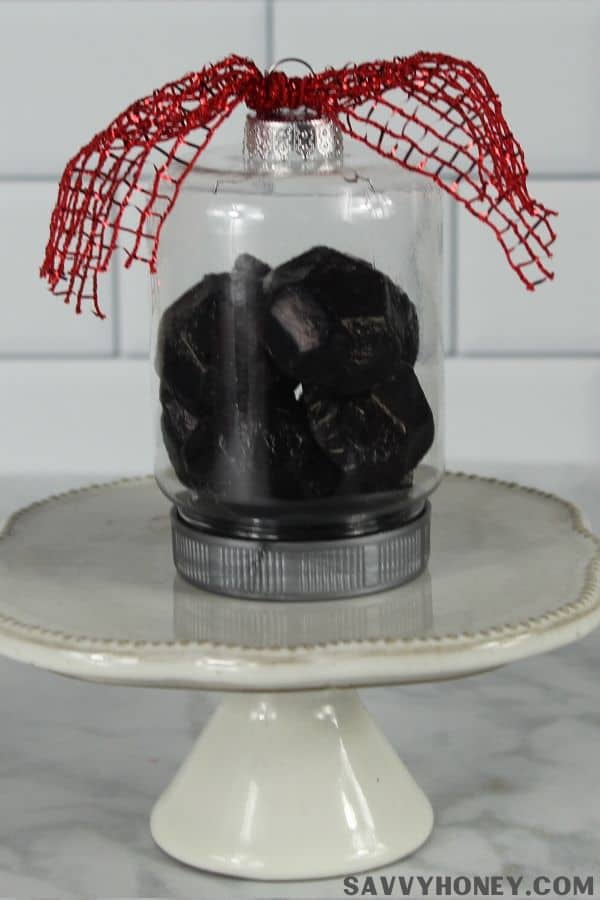 Dollar Tree ornament filled with lump of coal candy