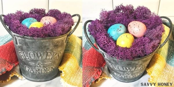 Easter nest on silver container with colorful eggs