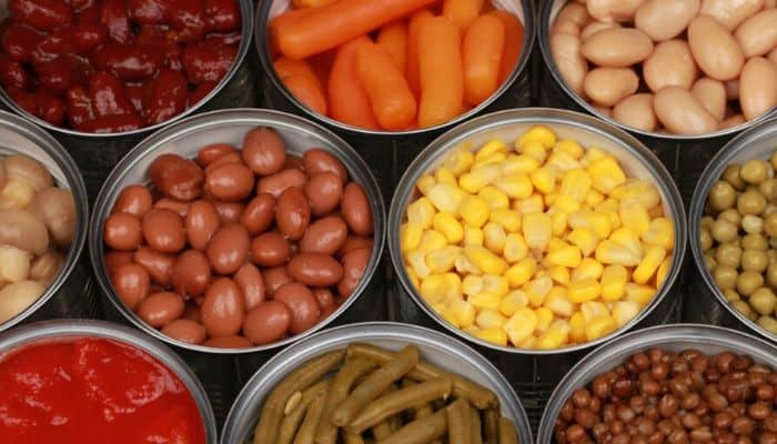Multiple cans of healthy non-perishable foods like beans, corn, etc.