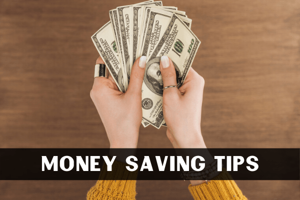 Woman holding dollar bills to save money for her 30 day savings plan