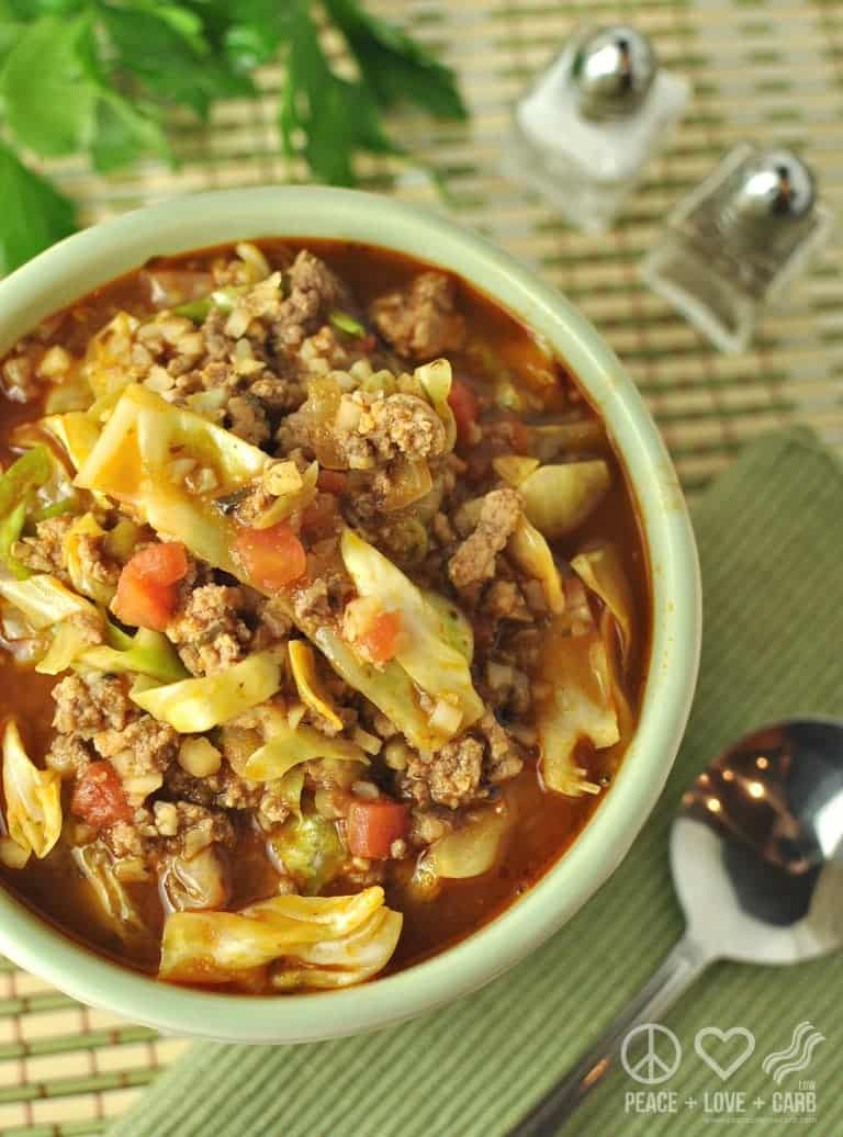 Keto Cabbage Roll Make Ahead Freezer soup in white bowl with green napkin on side and spoon