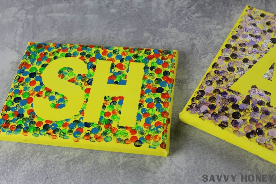 DIY Canvas Art with yellow initials with painted dot background