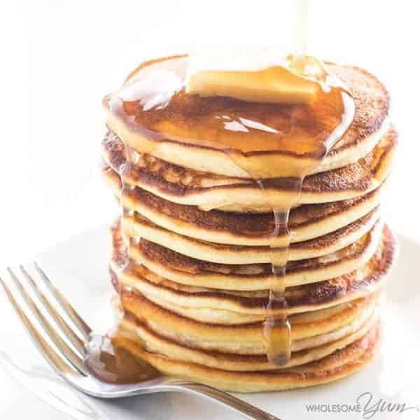 Easy Keto Pancakes Stacked and Dripping Syrup