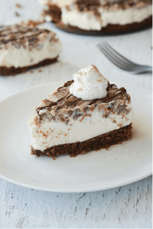 Keto Pecan Pie Cheesecake On A White Plate
