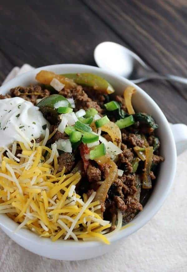 Keto Chilli Topped With Cheese In A White Bowl