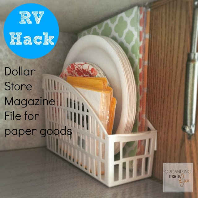dollar store white magazine holder organizing napkins and paper plates in a wood cabinet