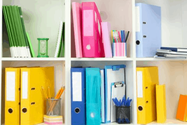 homeschool organizations idea of color coding. white cubby has one color of items in each cubby like yellow, blue, green, pink, etc.