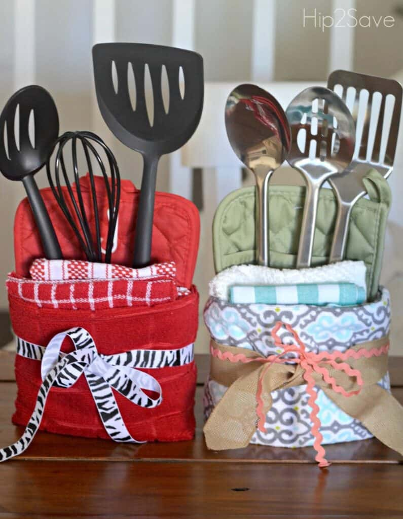 Cute Christmas potholders with towels and kitchen utensils inside, finished with ribbon.