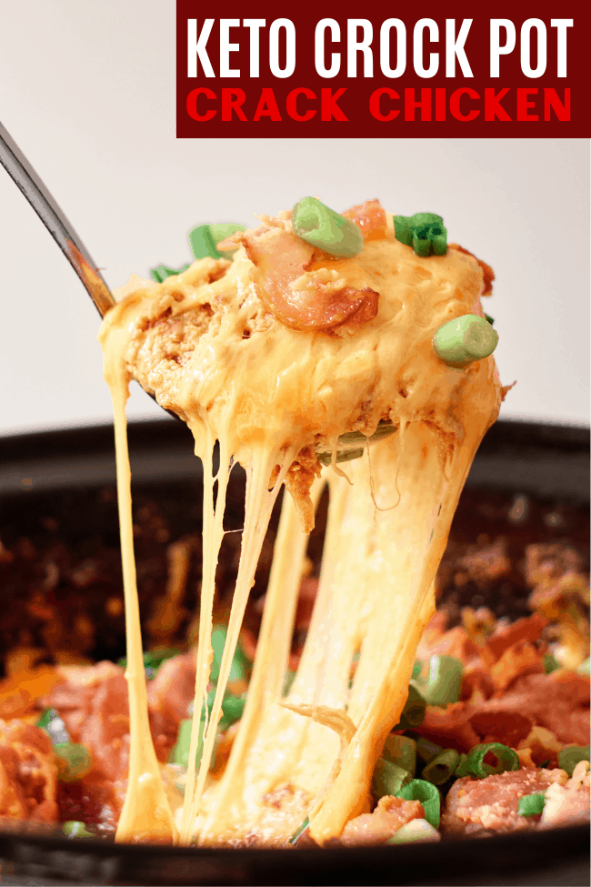 Crack chicken being served out of a crock pot with metal spoon, cheddar cheese strings hanging off spoon, tons of bacon and green onions in crock pot